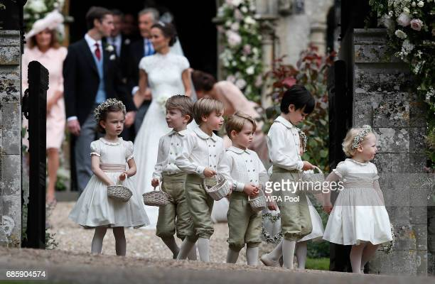Prince George fourth left stands with other flower boys and girls after the wedding of Pippa Middleton and James Matthews at St Mark's Church onMay...