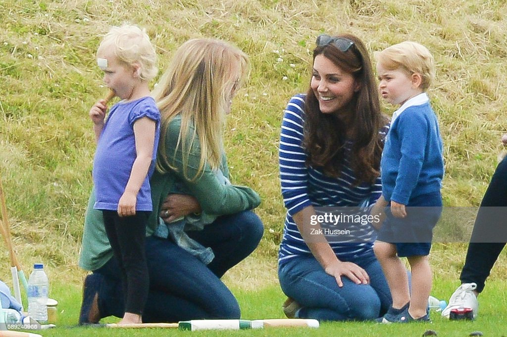Prince George Isla Phillips and their mothers Catherine Duchess of Cambridge and Autumn Phillips attend the Gigaset Charity Polo Match at the...