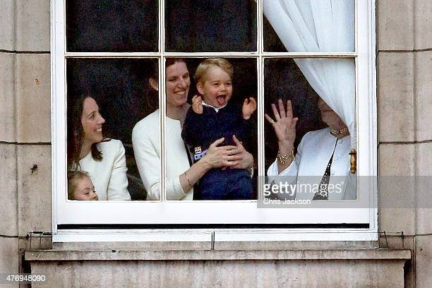 Prince George looks through a window in Buckingham Palace prior to the Trooping The Colour ceremony on June 13 2015 in London England The ceremony is...