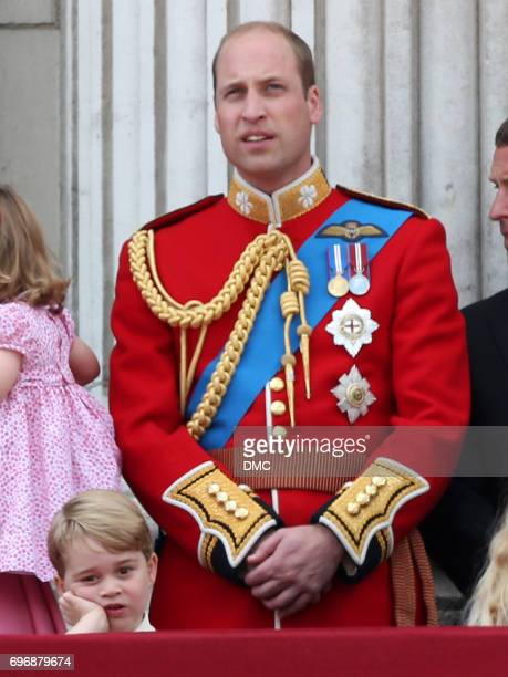 Prince George of Cambridge and Prince William Duke of Cambridge look out from the balcony of Buckingham Palace during the Trooping the Colour parade...