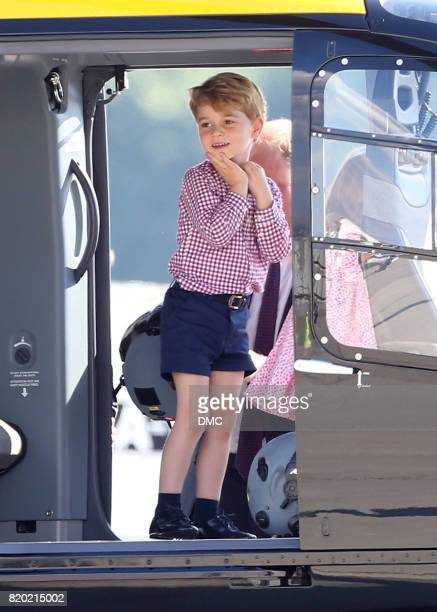 Prince George of Cambridge and Prince William Duke of Cambridge look at a helicopter at the Airbus factory during an official visit to Poland and...