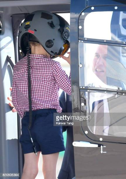 Prince George of Cambridge and Prince William Duke of Cambridge view helicopter models H145 and H135 before departing from Hamburg airport on the...