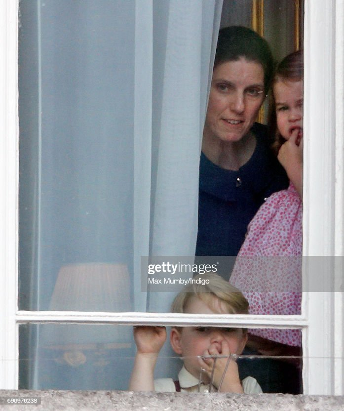 Prince George of Cambridge and Princess Charlotte of Cambridge, accompanied by their nanny Maria Teresa Borrallo, watch from a window of Buckingham Palace during the annual Trooping the Colour Parade on June 17, 2017 in London, England. Trooping the Colour is a military parade to mark Queen Elizabeth II's official birthday and dates back to the time of Charles II in the 17th Century when the Colours of a Regiment were used as a rallying point in battle.