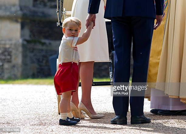 Prince George of Cambridge arrives at the Church of St Mary Magdalene on the Sandringham Estate for the Christening of Princess Charlotte of...