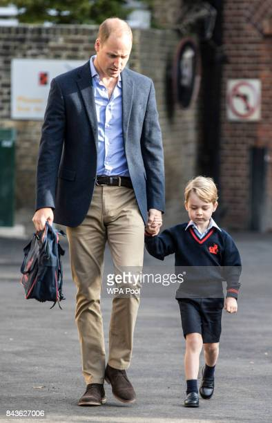 Prince George of Cambridge arrives for his first day of school with his father Prince William Duke of Cambridge at Thomas's Battersea on September 7...