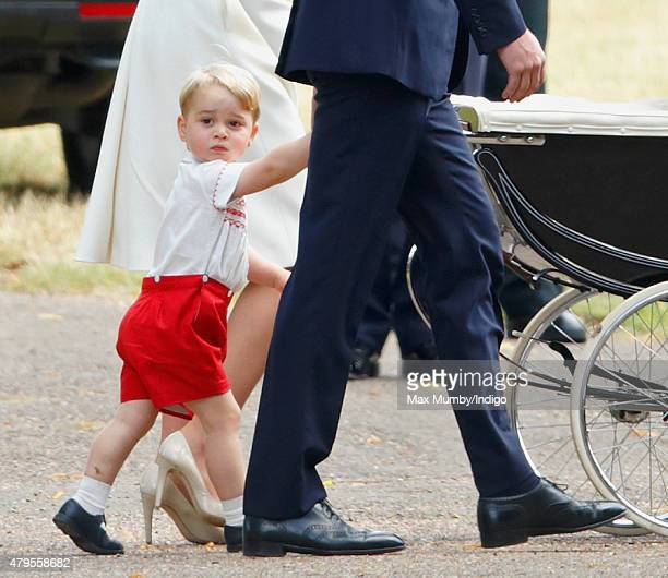 Prince George of Cambridge attends the christening of Princess Charlotte of Cambridge at the church of St Mary Magdalene on the Sandringham Estate on...