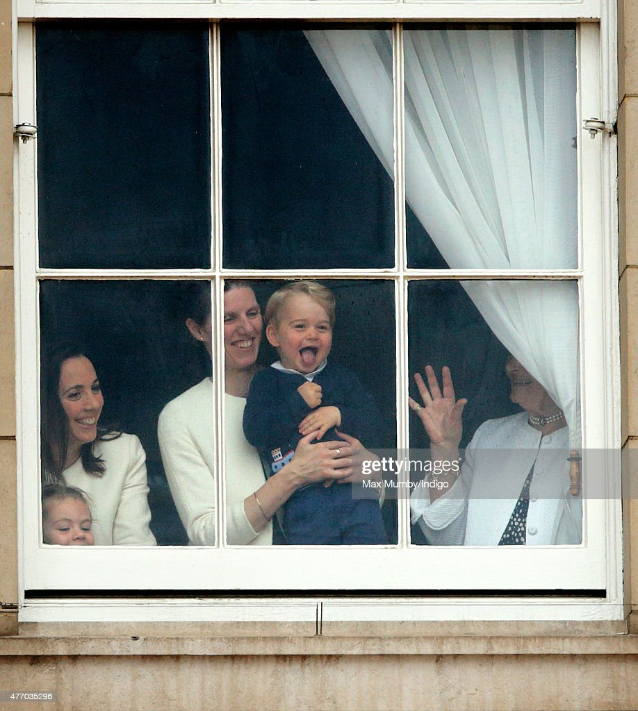 Prince George of Cambridge being held up at a window of Buckingham Palace by his nanny Maria Teresa Turrion Borrallo to watch Trooping the Colour on June 13, 2015 in London, England. The ceremony is Queen Elizabeth II's annual birthday parade and dates back to the time of Charles II in the 17th Century, when the Colours of a regiment were used as a rallying point in battle.