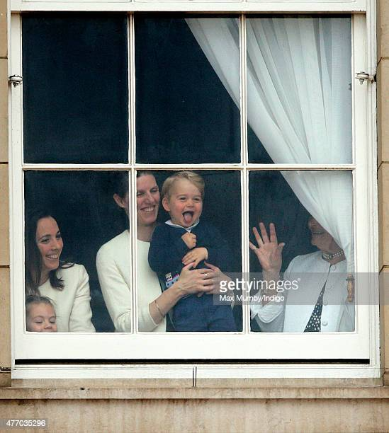 Prince George of Cambridge being held up at a window of Buckingham Palace by his nanny Maria Teresa Turrion Borrallo to watch Trooping the Colour on...