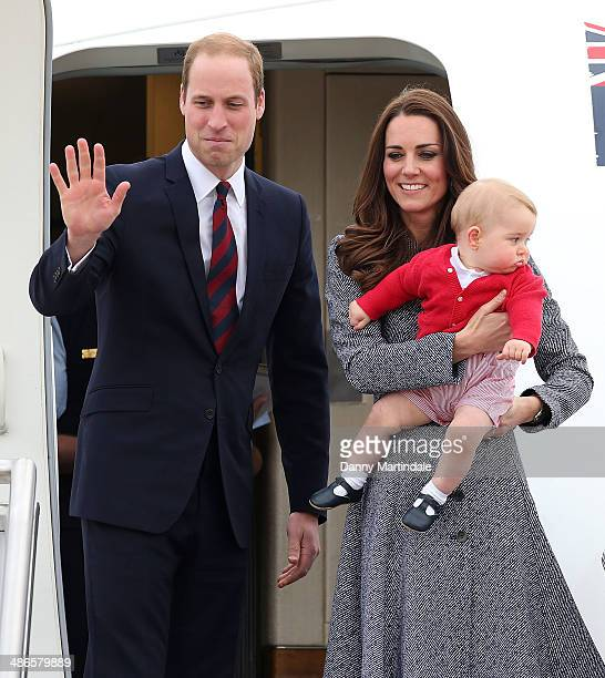 Prince George of Cambridge Catherine Duchess of Cambridge and Prince William Duke of Cambridge depart Fairbairn Defence Base on April 25 2014 in...
