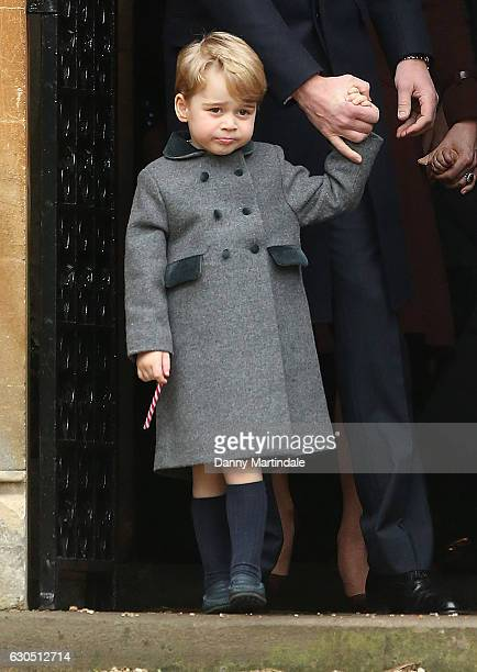 Prince George of Cambridge holds a candy cane after attending Church on Christmas Day on December 25 2016 in St Marks' Church in Englefield Berkshire
