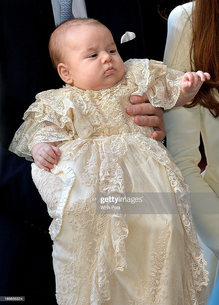 <a gi-track='captionPersonalityLinkClicked' href=/galleries/search?phrase=Prince+George+of+Cambridge&family=editorial&specificpeople=11176510 ng-click='$event.stopPropagation()'>Prince George of Cambridge</a> is carried by Prince William, Duke of Cambridge as they arrive at Chapel Royal in St James's Palace ahead of the christening by the Archbishop of Canterbury on October 23, 2013 in London, England.