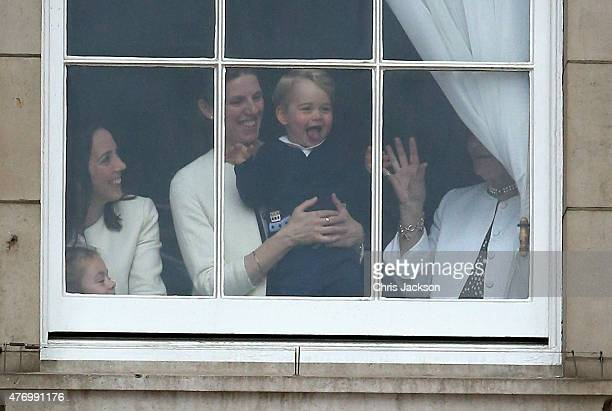 Prince George of Cambridge is held by his nanny Maria Teresa Turrion Borrallo as he waves from the window of Buckingham Palace as he watches the...