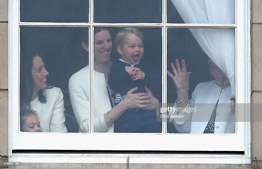 Prince George of Cambridge is held by his nanny Maria Teresa Turrion Borrallo as he waves from the window of Buckingham Palace as he watches the Trooping Tthe Colour on June 13, 2015 in London, England. The ceremony is Queen Elizabeth II's annual birthday parade and dates back to the time of Charles II in the 17th Century when the Colours of a regiment were used as a rallying point in battle.