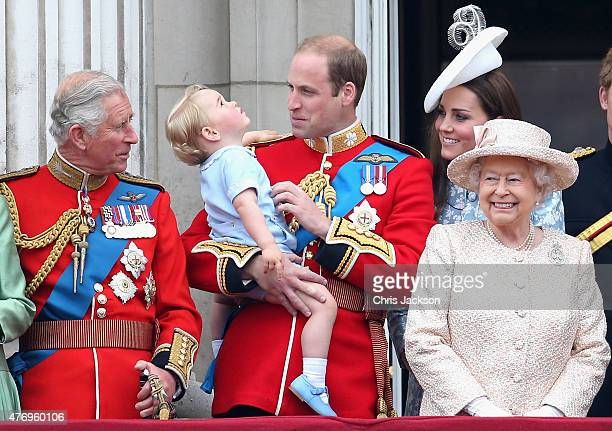Prince George of Cambridge is held by Prince William Duke of Cambridge and Catherine Duchess of Cambridge Prince Charles Prince of Wales and Queen...