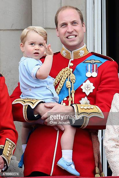 Prince George of Cambridge is held by Prince William Duke of Cambridge as Catherine Duchess of Cambridge Prince and Queen Elizabeth II they look out...
