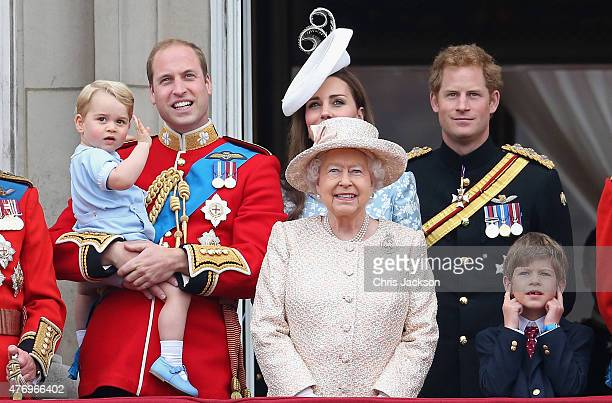 Prince George of Cambridge is held by Prince William Duke of Cambridge as Catherine Duchess of Cambridge Queen Elizabeth II and Prince Harry look out...