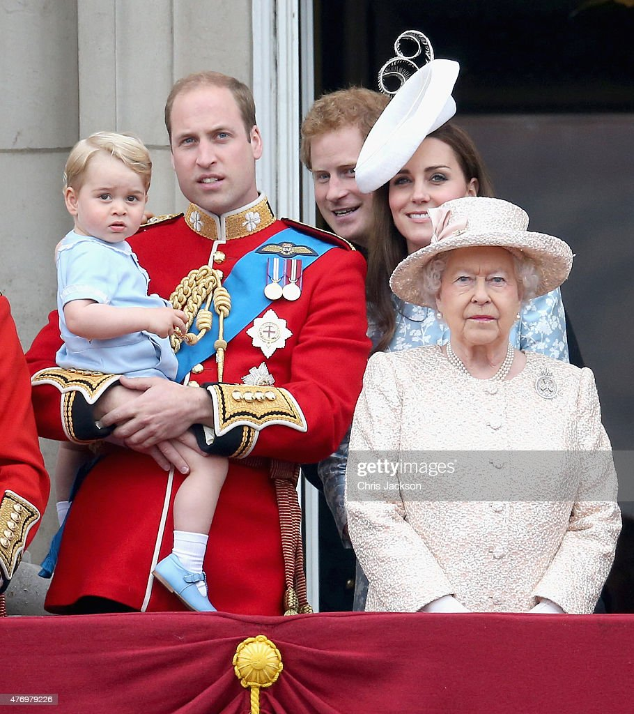 Prince George of Cambridge is held by Prince William Duke of Cambridge as Catherine Duchess of Cambridge Prince Harry and Queen Elizabeth II look out...