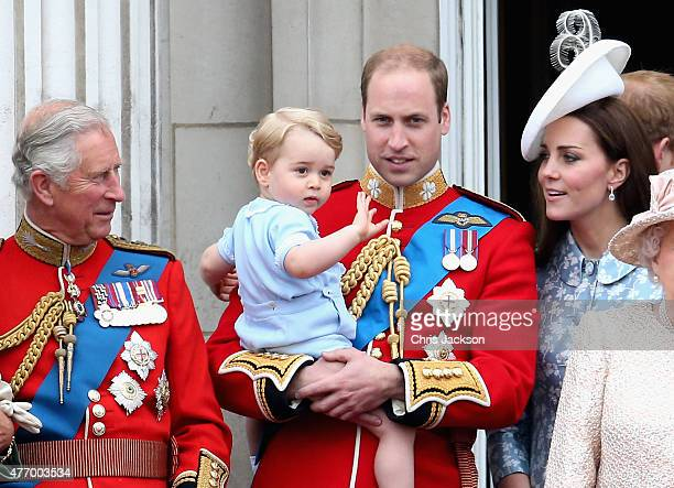 Prince George of Cambridge is held by Prince William Duke of Cambridge as Catherine Duchess of Cambridg and Prince Charles Prince of Wales watch on...
