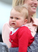 Prince George of Cambridge is seen in the arms of Catherine Duchess of Cambridge as they depart Fairbairn Defence Base on April 25 2014 in Canberra...