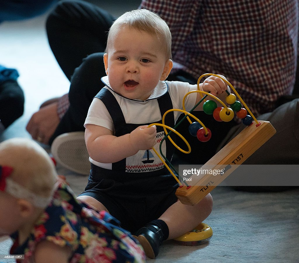 <a gi-track='captionPersonalityLinkClicked' href=/galleries/search?phrase=Prince+George+of+Cambridge&family=editorial&specificpeople=11176510 ng-click='$event.stopPropagation()'>Prince George of Cambridge</a> plays during a Plunket nurse and parents group visit at Government House on April 9, 2014 in Wellington, New Zealand. Plunket is a national not-for-profit organization that provides care for children and families in New Zealand. The Duke and Duchess of Cambridge are on a three-week tour of Australia and New Zealand, the first official trip overseas with their son, <a gi-track='captionPersonalityLinkClicked' href=/galleries/search?phrase=Prince+George+of+Cambridge&family=editorial&specificpeople=11176510 ng-click='$event.stopPropagation()'>Prince George of Cambridge</a>.