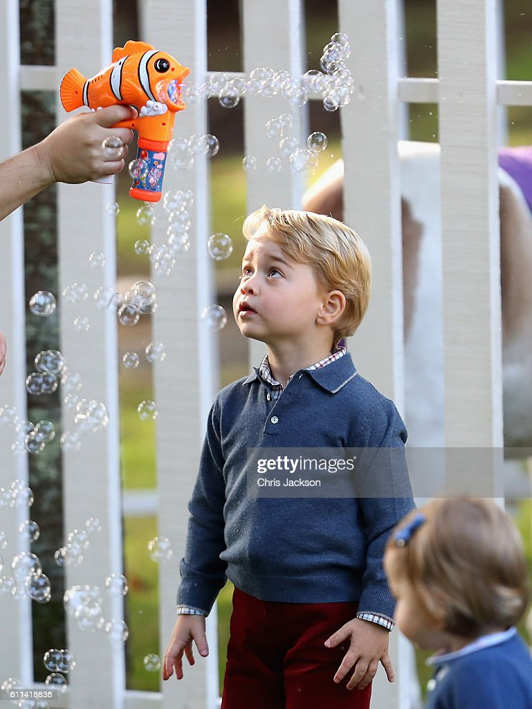 Prince George of Cambridge plays with bubbles at a children's party for Military families during the Royal Tour of Canada on September 29, 2016 in Victoria, Canada. Prince William, Duke of Cambridge, Catherine, Duchess of Cambridge, Prince George and Princess Charlotte are visiting Canada as part of an eight day visit to the country taking in areas such as Bella Bella, Whitehorse and Kelowna