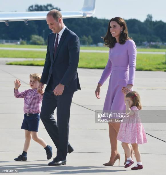 Prince George of Cambridge Prince William Duke of Cambridge Catherine Duchess of Cambridge and Princess Charlotte of Cambridge depart from Hamburg...