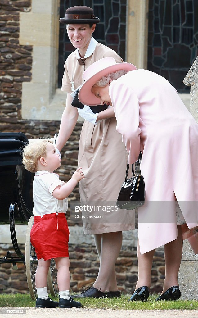 Prince George of Cambridge talks to Queen Elizabeth II outside the Church of St Mary Magdalene on the Sandringham Estate for the Christening of Princess Charlotte of Cambridge on July 5, 2015 in King's Lynn, England.