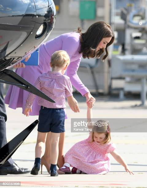 Prince George Princess Charlotte of Cambridge and Catherine Duchess of Cambridge view helicopter models H145 and H135 before departing from Hamburg...