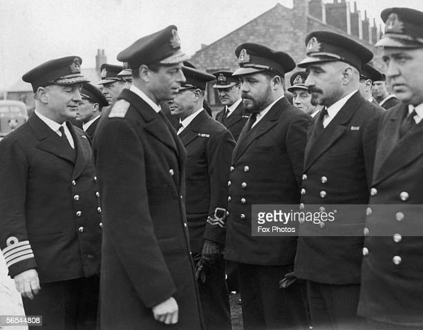 Prince George the Duke of Kent presents Distinguished Service medals to a British submarine crew at an east coast port during World War II 10th March...