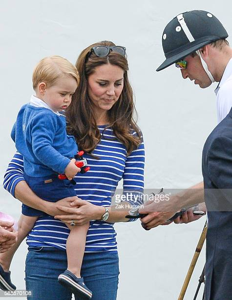 Prince George with a a toy car Catherine Duchess of Cambridge and Prince William Duke of Cambridge attend the Gigaset Charity Polo Match at the...