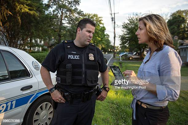 Prince George's County Police Department's public information officer and former TV news anchor Julie Parker live tweets during a ride along with...