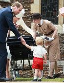 Prince George's nanny Maria Teresa Turrion Borrallo helps arrange Princess Charlotte of Cambridge's pram as she leaves the Church of St Mary...