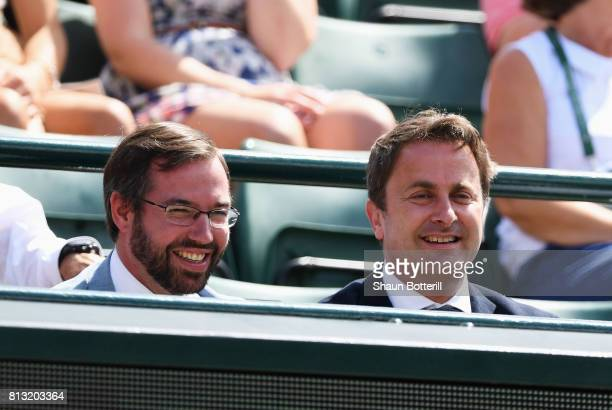 Prince Guillaume of Luxembourg and Luxembourg's Prime Minister Xavier Bettel look on prior to the Gentlemen's Singles quarter final match between...