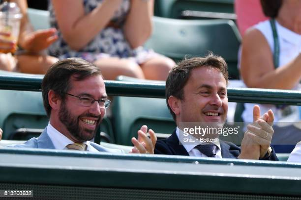 Prince Guillaume of Luxembourg and Luxembourg's Prime Minister Xavier Bettel applaud during the Gentlemen's Singles quarter final match between...