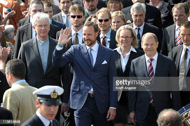 Prince Haakon of Norway and Hamburgs First Major Olaf Scholz arrive for the open ceremony of the 822nd port anniverary on the Rickmer Rickmers museum...