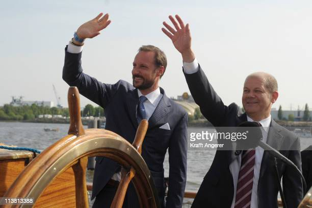 Prince Haakon of Norway and Hamburgs First Major Olaf Scholz wave during the open ceremoiny of the 822nd port anniverary on the Rickmer Rickmers...