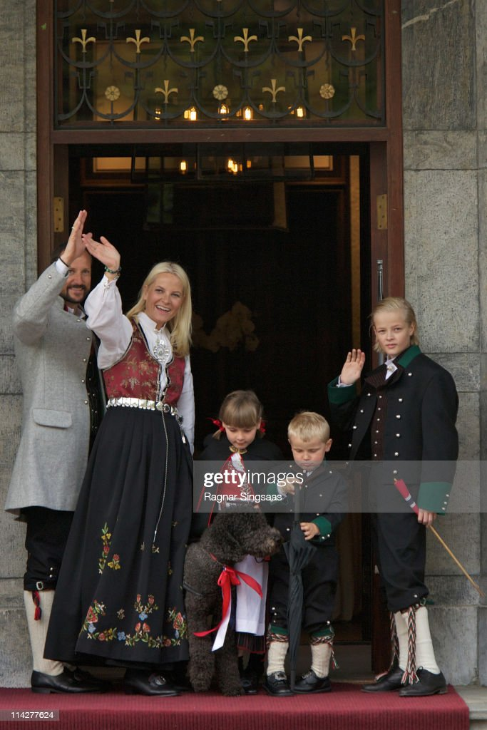 Prince Haakon of Norway, Princess Mette-Marit of Norway, Princess Ingrid Alexandra of Norway, Prince Sverre Magnus of Norway, Marius Borg Hoiby and their dog Milly Kakao attend the Children's Parade during Norwegian National Day on May 17, 2011 in Asker, Norway.