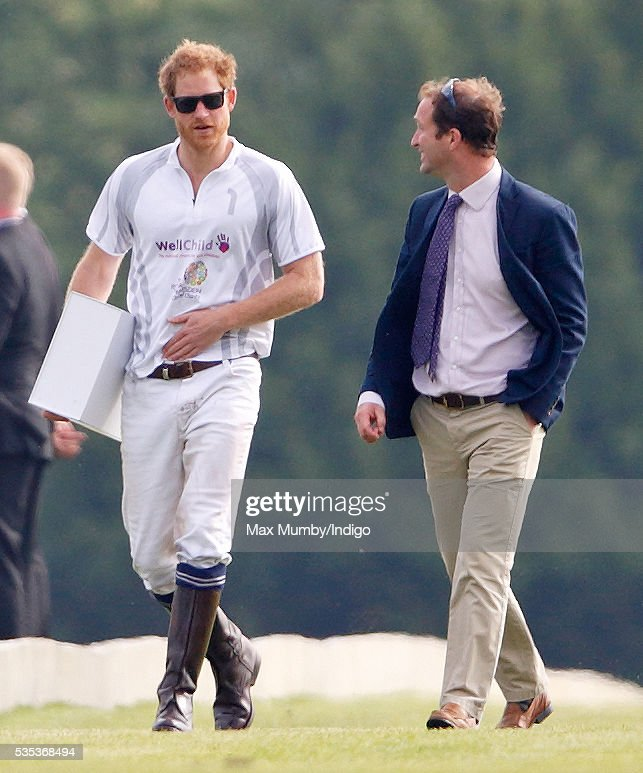 Prince Harry accompanied by his polo manager Andrew Tucker attends the Audi Polo Challenge at Coworth Park Polo Club on May 29, 2016 in Ascot, England.