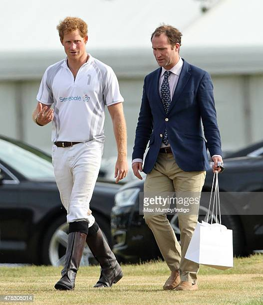 Prince Harry and Andrew Tucker Prince William and Prince Harry's Polo Manager attend day 1 of the Audi Polo Challenge at Coworth Park on May 30 2015...