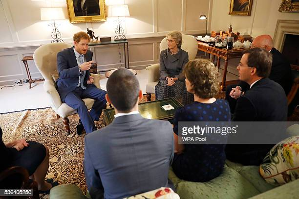 Prince Harry and Birgitte Duchess of Gloucester in her capacity as Papworth Hospital's Royal Patron talk after presenting Staff Sergeant Elizabeth...