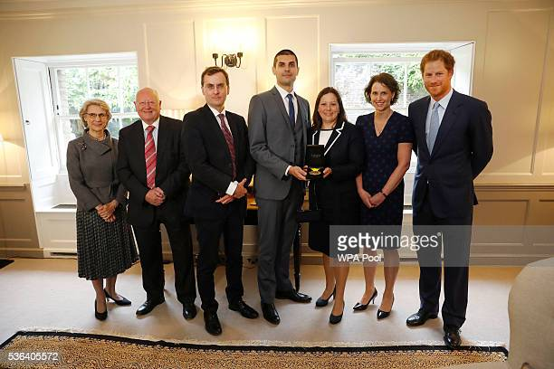 Prince Harry and Birgitte Duchess of Gloucester in her capacity as Papworth Hospital's Royal Patron pose for a group photograph with Papworth...