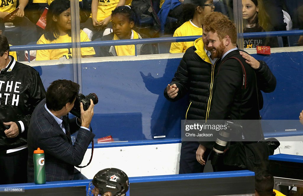 <a gi-track='captionPersonalityLinkClicked' href=/galleries/search?phrase=Prince+Harry&family=editorial&specificpeople=178173 ng-click='$event.stopPropagation()'>Prince Harry</a> and Canadian Prime Minister <a gi-track='captionPersonalityLinkClicked' href=/galleries/search?phrase=Justin+Trudeau&family=editorial&specificpeople=2616495 ng-click='$event.stopPropagation()'>Justin Trudeau</a> joke with the Prime Minister's photographer as they watch a sledge-hockey match Mattany at the Athletic Centre on May 2, 2016 in Toronto, Canada. <a gi-track='captionPersonalityLinkClicked' href=/galleries/search?phrase=Prince+Harry&family=editorial&specificpeople=178173 ng-click='$event.stopPropagation()'>Prince Harry</a> is in Toronto for the Launch of the 2017 Toronto Invictus Games before heading down to Miami and the 2016 Invictus Games in Orlando.