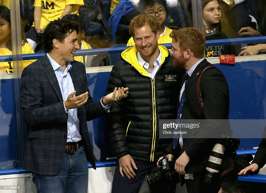 Prince Harry and Canadian Prime Minister Justin Trudeau joke with the Prime Minister's photographer as they watch a sledge-hockey match Mattany at the Athletic Centre on May 2, 2016 in Toronto, Canada. Prince Harry is in Toronto for the Launch of the 2017 Toronto Invictus Games before heading down to Miami and the 2016 Invictus Games in Orlando.