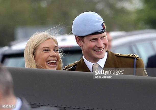 Prince Harry and Chelsy Davy laugh as they attend Prince Harry's Pilot Course Graduation at the Army Aviation Centre on May 7 2010 in Andover England...