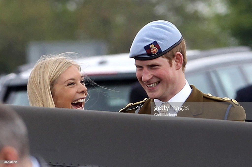 Prince Harry and Chelsy Davy laugh as they attend Prince Harry's Pilot Course Graduation at the Army Aviation Centre on May 7, 2010 in Andover, England. The Prince of Wales, Colonel in Chief, presented flying badges to students, including Prince Harry who had successfully completed the Operational Training Phase of the Army Air Corps. It was announced today that Prince Harry will fly Apache helicopters during the next section of his training.