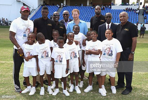 Prince Harry and cricketers Alzarri Joseph Vivian Richards Curtly Ambrose and Andy Roberts attend a youth sports festival at Sir Vivian Richards...