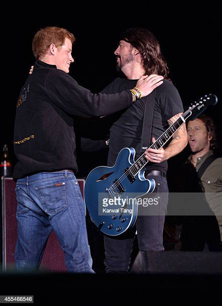 Prince Harry and Dave Grohl from the Foo Fighters attend the Invictus Games closing ceremony at Queen Elizabeth Olympic Park on September 14 2014 in...