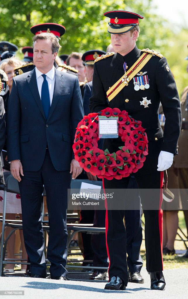 Prince Harry and David Cameron attend the Service of Dedication to inaugurate the Bastion Memorial at The National Memorial Arboretum on June 11, 2015 in Stafford, England.