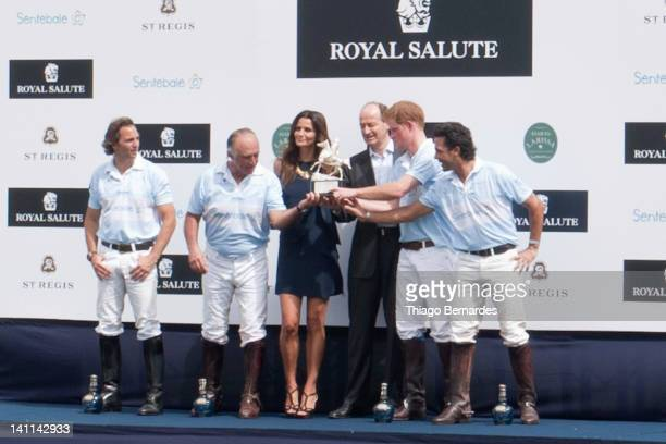 Prince Harry and Fernanda Motta during a premiation Ceremony of the Sentebale Royal Salute Polo Cup 2012 at Haras Larissa on March 11 2012 in...