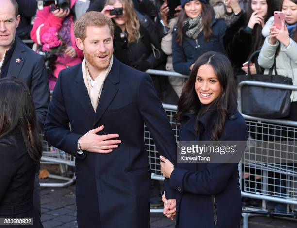 Prince Harry and fiancee Meghan Markle attend the Terrence Higgins Trust World AIDS Day charity fair at Nottingham Contemporary on December 1 2017 in...